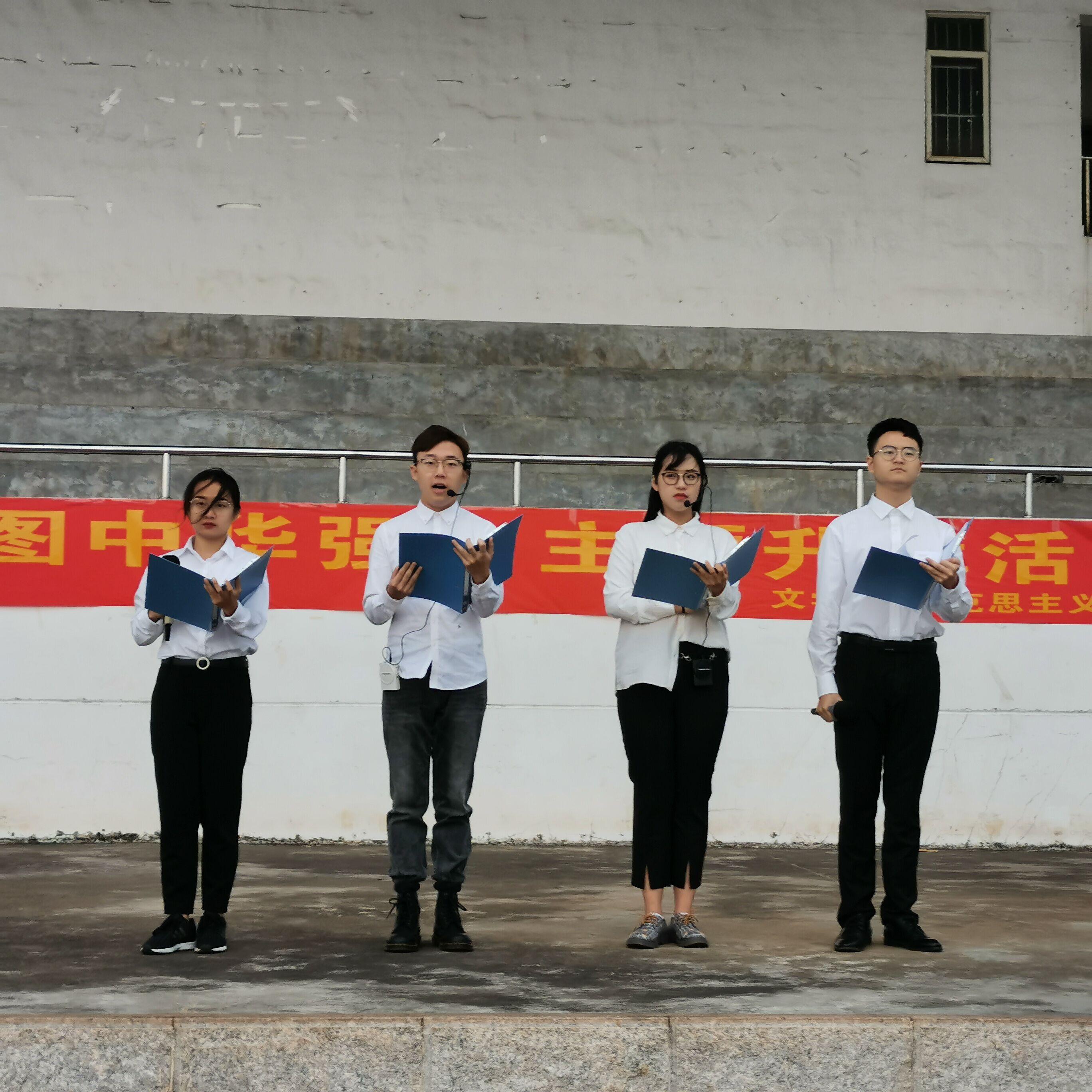 青年之声・勿忘一二九 共筑中国强――记马克思主义学院文学院共同举办主题升旗仪式